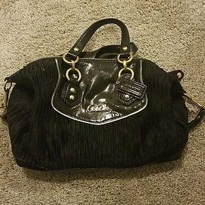 Black with gold details coach purse